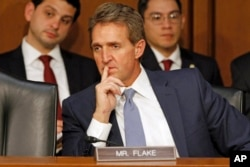 "FILE - Arizona Senator Jeff Flake, who openly rooted against Donald Trump early in the nominating process, said of the latter's virtual wrap-up of the nomination, ""I don't think fences need mending."""