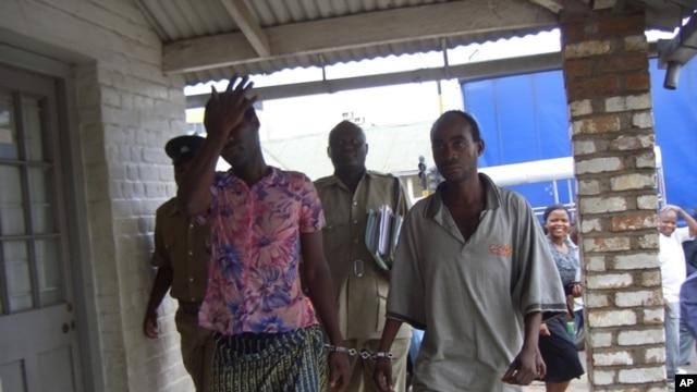 Tiwonge Chimbalanga and Steven Monjeza are taken into custody after celebrating their engagement (photo by Lameck Masina)