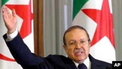 FILE - In this Aug. 14, 2005, photo, Algeria's President Abdelaziz Bouteflika addresses the nation's top officials in Algiers.