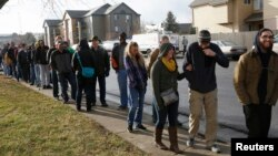 FILE - People wait in line to be among the first to legally buy recreational marijuana at the Botana Care store in Northglenn, Colorado, Jan. 1, 2014.