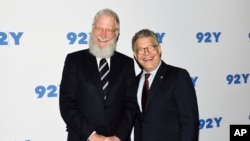 FILE - Sen. Al Franken, D-Minn., right, and former talk show host David Letterman arrive for their conversation at 92Y in New York, May 30, 2017.