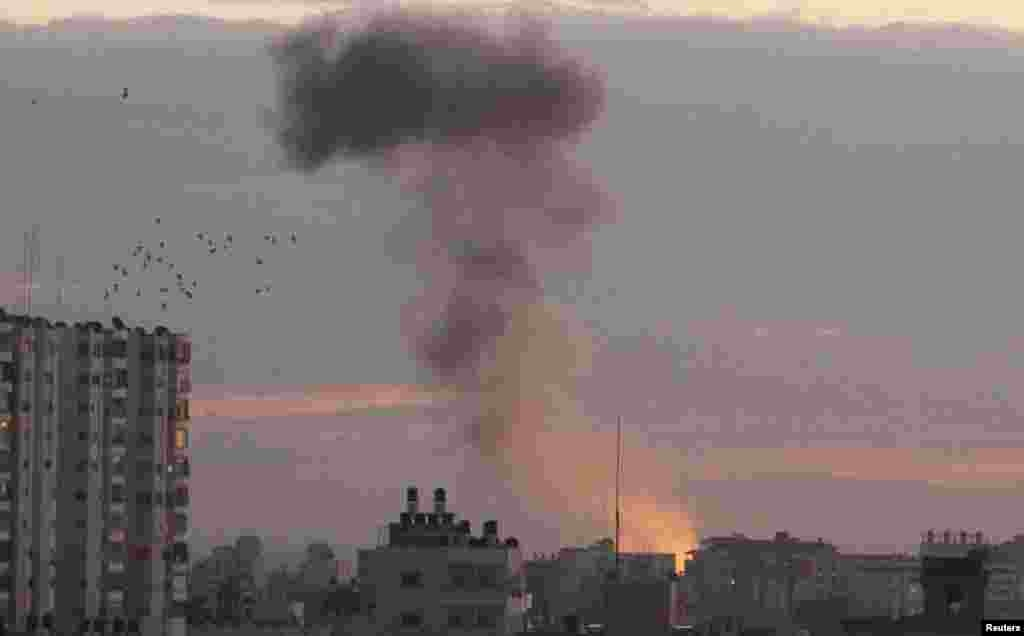 Smoke rises following Israeli air strikes in Gaza City, November 14, 2012.