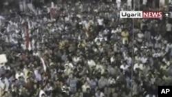 叙利亚民众在拉斯坦城举行抗议示威 要求阿萨德总统下台