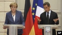 German Chancellor Angela Merkel, left, and France's President Nicolas Sarkozy during their joint press conference at the Elysee Palace, August 16, 2011