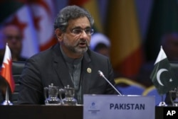 FILE - Pakistan's Prime Minister Shahid Khaqan Abbasi addresses the Organisation of Islamic Cooperation's Extraordinary Summit in Istanbul, Dec. 13, 2017.