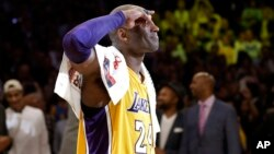 Los Angeles Lakers' Kobe Bryant solutes as he acknowledges fans after the last NBA basketball game of his career, against the Utah Jazz on Wednesday, April 13, 2016.