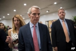 Senator Rob Portman heads to the Capitol last month for a vote.