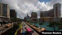 FILE - Traffic flows past gaming resorts at Cotai Strip in Macau, May 15, 2018.