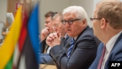 Estonian Foreign Minister Urmas Paet (R) listens to counterpart Frank-Walter Steinmeier from Germany (2dR), as they give a joint press conference with Linas Linkevicius from Lithuania (L) and Edgars Rinkevics from Latvia (2dL) following their meeting focu