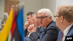 Estonian Foreign Minister Urmas Paet, far right, listens to counterpart Frank-Walter Steinmeier from Germany, second from right, at Baltic regional security meeting, Tallinn, June 17, 2014.