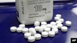 FILE - This Feb. 19, 2013, file photo, shows OxyContin pills arranged for a photo at a pharmacy in Montpelier, Vermont.