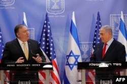 U.S. Secretary of State Mike Pompeo (left) and Israeli Prime Minister Benjamin Netanyahu deliver a joint statement during their meeting in Jerusalem on March 20, 2019.