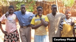 Photo of five people who escaped the LRA and went to a Safe Reporting Site in the Central African Republic in November 2012.