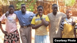 Photo of 5 people who escaped the LRA and escaped to a Safe Reporting Site in Central African Republic in November 2012.