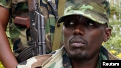 FILE - General Sultani Makenga, military leader of the M23 rebels, addresses the media in Bunagana, in eastern Democratic Republic of Congo.