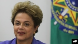 Brazil's President Dilma Rousseff meets with women rural workers at Planalto Presidential Palace in Brasilia, Brazil, Aug. 6, 2015.