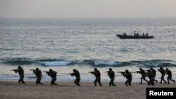 FILE - Pakistan Navy's special service group conduct a maritime counter-terrorism demo during an exercise in Karachi, Pakistan February 9, 2019.