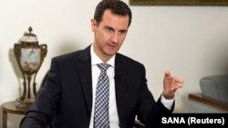 Le président Bashar al-Assad lors d'une interview au quotidien espagnol El Pais à Damas, le 20 février 2016.