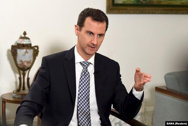FILE - Syria's President Bashar al-Assad in Damascus, Feb. 20, 2016.