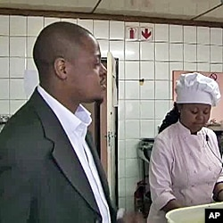 Sakhumzi Maqupela in kitchen of his restaurant in Soweto