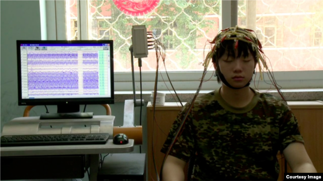 "A Chinese teen receives treatment at an Internet addiction camp in a still from the new documentary ""Web Junkie."""