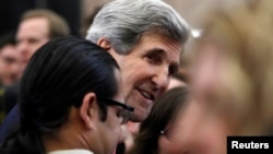 John Kerry, the new U.S. Secretary of State, greets employees of the State Department in Washington February 4, 2013. Today is Kerry's first official day at the State Department. REUTERS/Gary Cameron (UNITED STATES - Tags: POLITICS) - RTR3DCG7