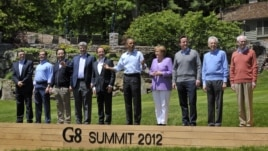 World leaders attend the family photo session during the G8 Summit at Camp David, Maryland, May 19, 2012.