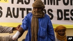 Alhader Ag Almahmoud, a 30-year-old Tuareg herder whose right hand was amputated last month by an Islamist group, displays his bandaged arm at an Amnesty International press conference in Bamako, Mali, September 20, 2012.