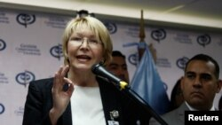 FILE - Venezuela's chief prosecutor Luisa Ortega Diaz talks to the media during a news conference in Caracas, Venezuela, May 24, 2017.
