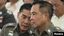 The next Thai national police chief Chakthip Chaijinda (L) talks with Thai national police chief Somyot Pumpanmuang (R) during a religious ceremony near the Erawan shrine, the site of Monday's deadly blast, in central Bangkok, Thailand, August 21, 2015.