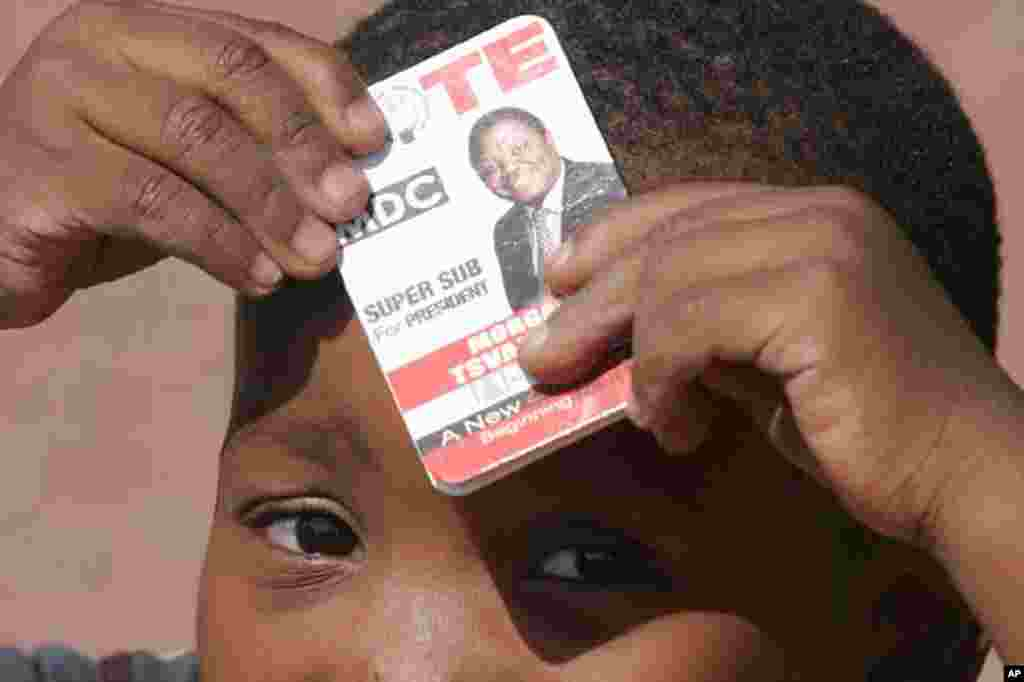 A child holds a sticker at a Movement for Democratic Change (MDC) supporters rally for those lliving in exile in South Africa at a protest rally in Johannesburg. The Movement for Democratic Change, which claimed its leader Morgan Tsvangirai won the March 29 presidential ballot said it would not accept a recount, did not want a runoff and pressed ahead with legal attempts to force the publication of the results.