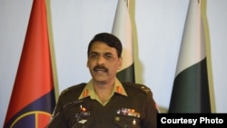 FILE - Pakistani Army spokesman Major-General Asif Ghafoor holds a press briefing.