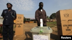 A man votes at a polling station in Kibi, in eastern Ghana and stronghold of opposition presidential candidate Nana Akufo-Addo on Dec. 7, 2012.