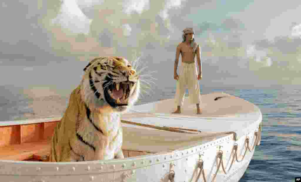 "This film image released by 20th Century Fox shows Suraj Sharma as Pi Patel in a scene from ""Life of Pi."" (20th Century Fox)"