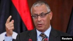 PM Libya Ali Zeidan dalam konferensi pers di Tripoli (foto: dok). Kelompok Islamis Libya mencurigai keterlibatan Zeidan dalam penangkapan warga Libya oleh pasukan khusus AS.