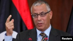 Libya's Prime Minister Ali Zeidan speaks during a news conference at the headquarters of the Prime Minister's Office in Tripoli, Jan. 3, 2013.