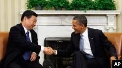 奧巴馬今年2月在白宮會見習近平 (路透社)