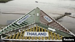 Border sign on Mekong River