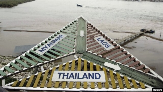 A sign at the Thai village of Sop Ruak on the Mekong river in the Golden Triangle,  the opium-growing region straddling Myanmar, Laos and Thailand. Picture taken on January 14, 2012.