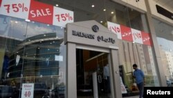 Like many other Saudi retailers, a clothing store in Riyadh offers huge sales to entice consumers. The ripple effect of Saudi Arabia's falling oil prices means its residents have less to spend for the Eid holiday period.