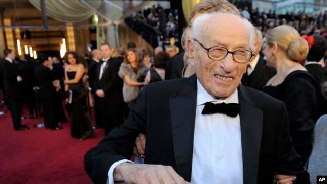 FILE - Eli Wallach arrives before the 83rd Academy Awards.