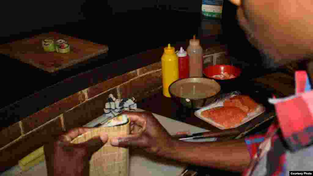 Khumalo sculpts a tasty mouthful of sushi for a hungry customer. (Photo by Darren Taylor)