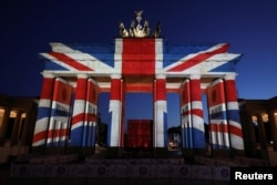 The Brandenburg Gate is illuminated with the colours of the British flag to show solidarity with the victims of the recent attack in London, in Berlin, Germany June 4, 2017.