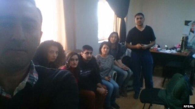 Azerbaijani authorities detain RFE/RL's Baku bureau staff during an office raid, Dec. 26, 2014.