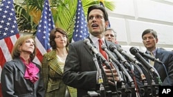 House Majority Leader Eric Cantor of Va., center, speaks about the upcoming vote to repeal the health care bill during a news conference on Capitol Hill in Washington, flanked by other GOP House representatives, 19 Jan, 2011