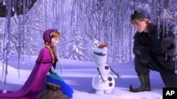 "This image released by Disney shows, from left, Anna, voiced by Kristen Bell, Olaf, voiced by Josh Gad, and Kristoff, voiced by Jonathan Groff in a scene from the animated feature ""Frozen."" (AP Photo/Disney)"