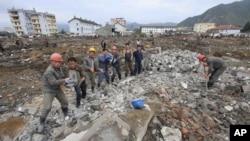2016年9月16日洪水破坏地区恢复工作进行中