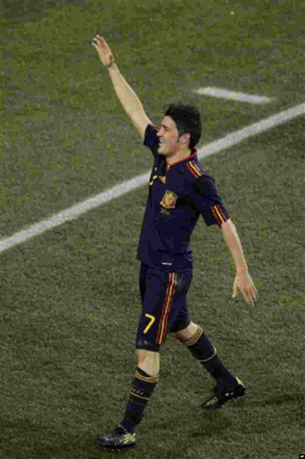Spain's David Villa celebrates after scoring a goal during the World Cup quarterfinal soccer match between Paraguay and Spain at Ellis Park Stadium in Johannesburg, South Africa, Saturday, July 3, 2010. Spain won 1-0. (AP Photo/Themba Hadebe)