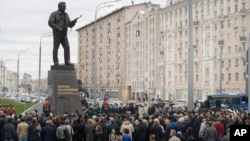 A monument to Russian firearm designer Mikhail Kalashnikov is unveiled during a ceremony in Moscow, Russia, Sept. 19, 2017.
