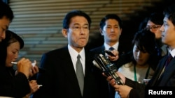 FILE - Japan's Foreign Minister Fumio Kishida listens to questions from reporters at Prime Minister Shinzo Abe's official residence in Tokyo.